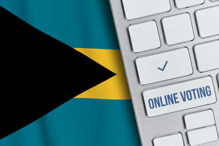 Online voting concept in Commonwealth of The Bahamas. Keyboard near country flag Banque d'images