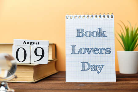9th august - Book Lovers Day. Ninth day month calendar concept on wooden blocks.