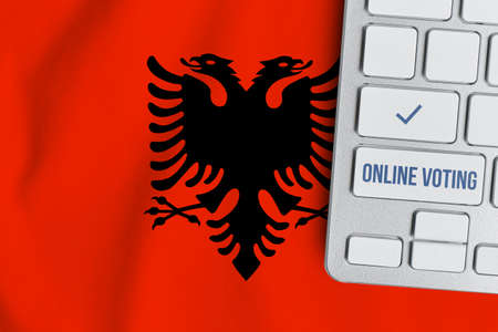 Online voting concept in Republic of Albania. Keyboard near country flag