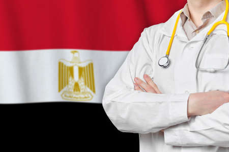 Arab Republic of Egypt healthcare concept with doctor on flag background. Medical insurance, work or study in the country Banque d'images