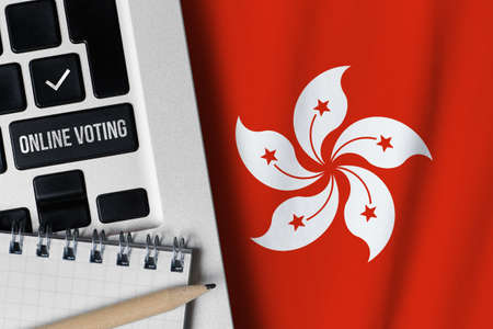 Online voting concept in Hong Kong. Keyboard near country flag Banque d'images