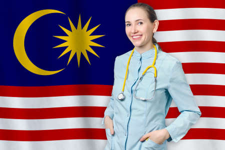 Malaysia healthcare concept with doctor on flag background. Medical insurance, work or study in the country