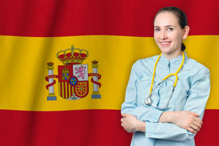Kingdom of Spain healthcare concept with doctor on flag background. Medical insurance, work or study in the country