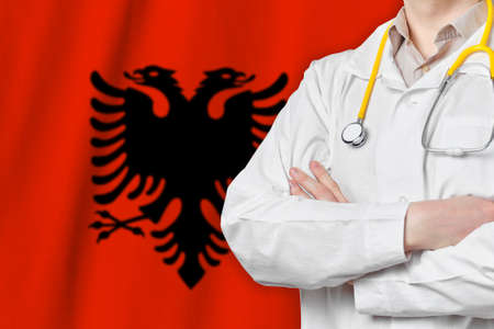 Republic of Albania healthcare concept with doctor on flag background. Medical insurance, work or study in the country Banque d'images