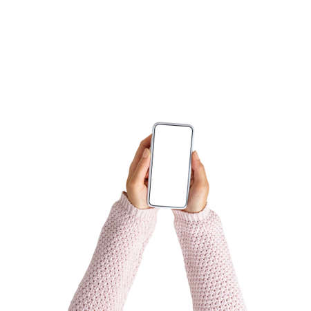 Girls hands with smartphone with top view on white background. Isolated.
