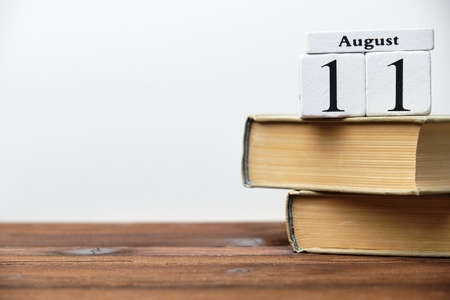 11th august - eleventh day month calendar concept on wooden blocks with copy space