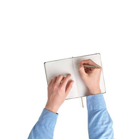Male hands in a shirt are taking notes in a diary. top view and white background. Isolated
