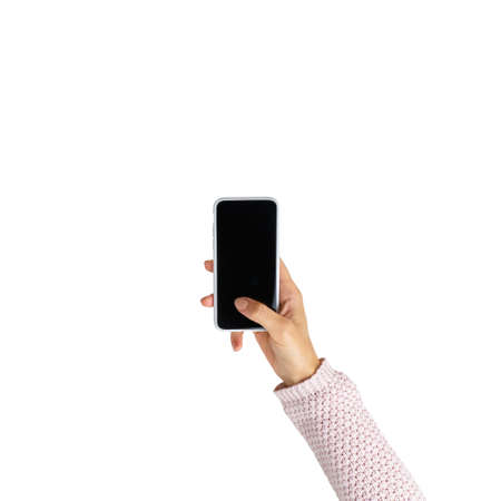Woman hand holds a smartphone. top view and white background. Isolated