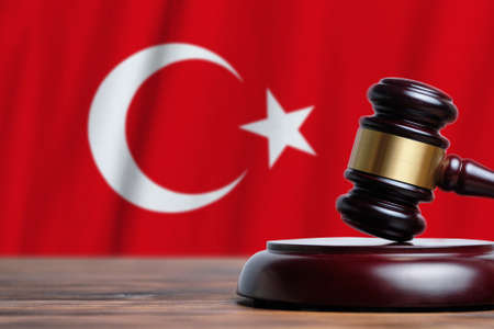 Justice and court concept in Republic of Turkey. Judge hammer on a flag background. 写真素材