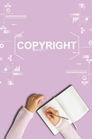 Copyright concept with abstract graphics and hands with diary on pink background. Stock fotó