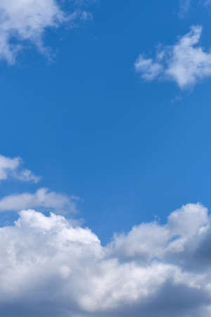 Blue and sunny sky with white clouds in the summer