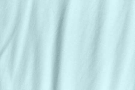 Silk fabric in turquoise color as background and texture.