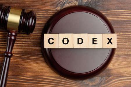 Codex word on wooden blocks next to judge hammer.