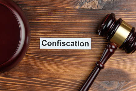 The word confiscation on a white sticker next to the judge hammer.