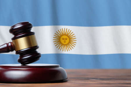 Justice and court concept in Argentine Republic. Judge hammer on a flag background. 写真素材