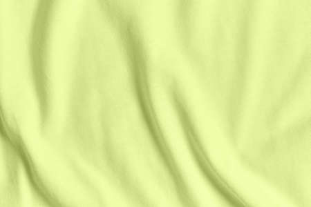 Texture and background of crumpled light green color fabric. Standard-Bild