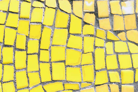 Abstract mosaic background with yellow pieces. Close up Standard-Bild