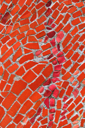 Abstract mosaic background with red pieces. Close up Standard-Bild