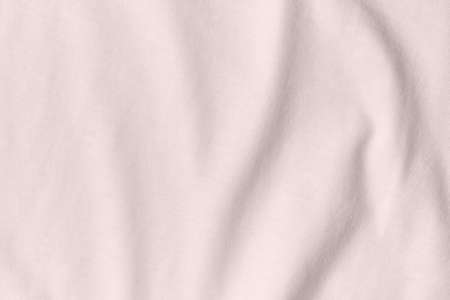 Texture and background of crumpled cream fabric.