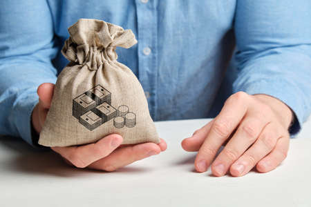 A bag with a picture of money in the hand of a man in a shirt. The concept of savings
