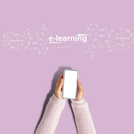 E-learning concept. Hands hold a smartphone on a pink background