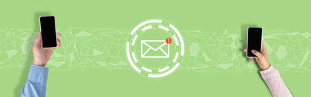 Email concept. Hands with a smartphone on a green background with graphics Stock fotó