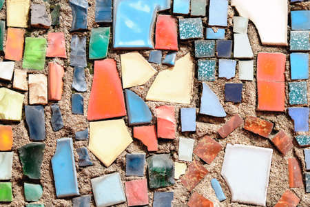 A wall of different color crushed mosaics as a background Standard-Bild
