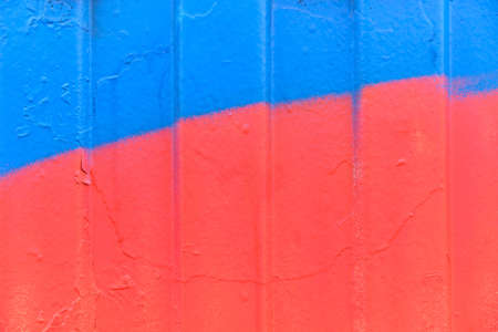 Metal siding painted in red and blue. Standard-Bild