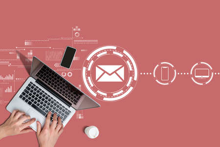 Email communication concept with hands and laptop.
