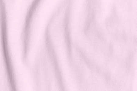 Texture and background of crumpled pink fabric.