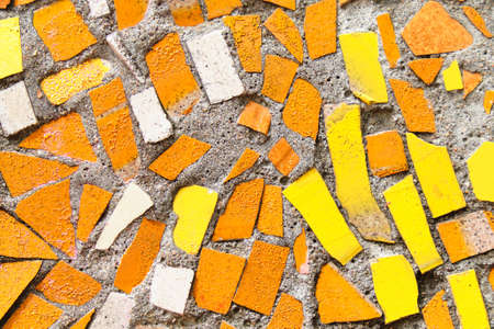 Yellow and orange mosaic texture and background.