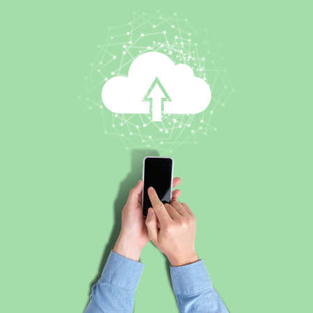 Concept of uploading data from phone to cloud service. Stock fotó