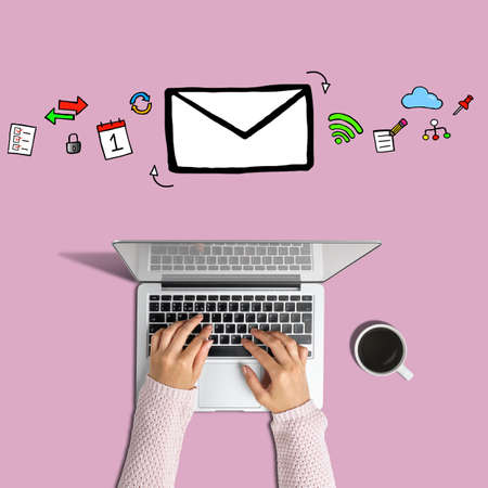 Email communication concept. Hands with laptop and email icon Stock fotó