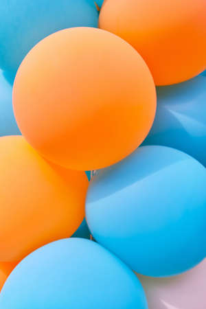 Multicolored balls as a background or texture in blue and orange colors. Banque d'images