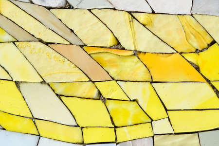 Broken mosaic texture of yellow and white pieces.