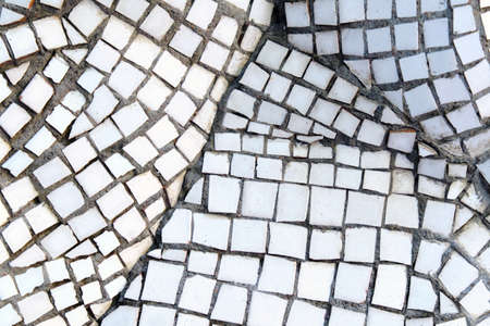 Texture from a mosaic of white pieces.