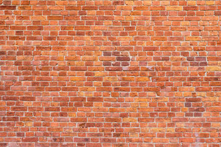 Big background of an old brick wall. Standard-Bild