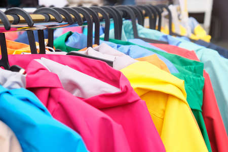 Hanger of autumn colorful jackets in the store.