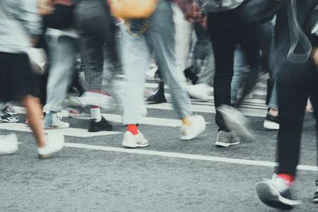 Blurred pedestrian traffic on the street of a European city.