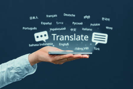 The concept of a program for translating in a smartphone from different languages. Stock fotó