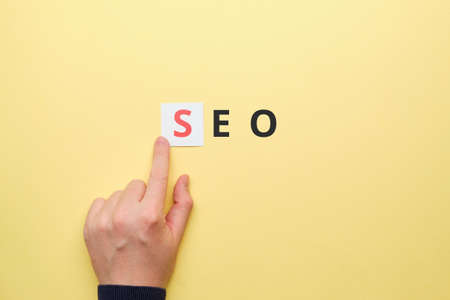 Person points finger at search engine optimization. Stock Photo