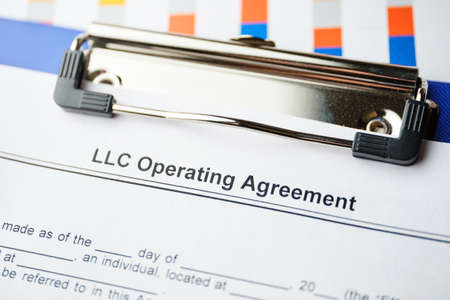 Legal document LLC Operating Agreement on paper.