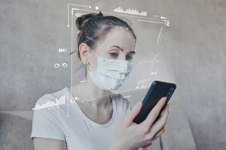 The concept of identifying the health of a person on self-isolation through biometric technologies scanning eyes using a phone. Covid-19 quarantine