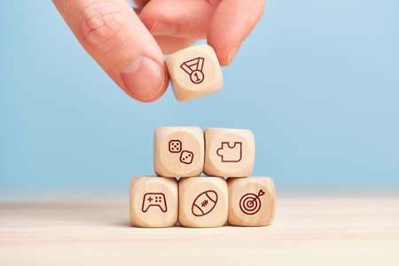 Concept of different games on wooden cubes built by hand