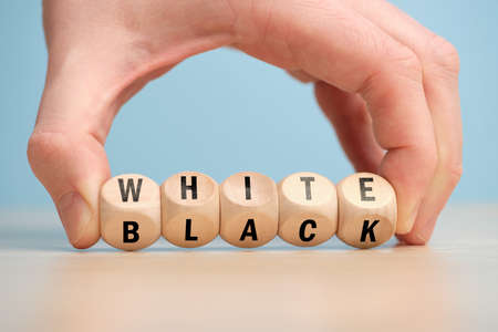 Concept of antonym white and black on wooden blocks.