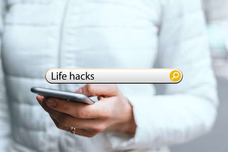 concept life hacks in the search bar on the background of a woman with phone