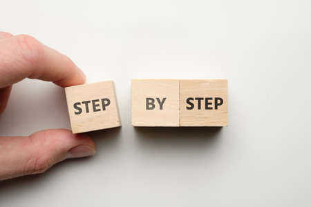 The businessman builds an abstract strategy step by step