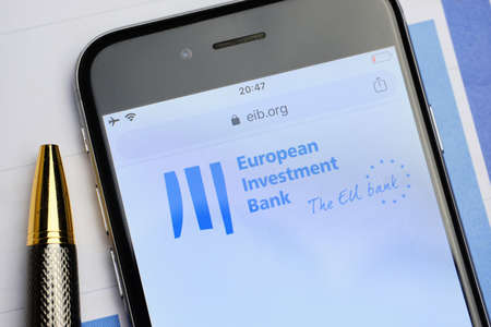 russia, st.petersburg, 14 February 2021 logo European Investment Bank on the website screen through a magnifier. Close up.