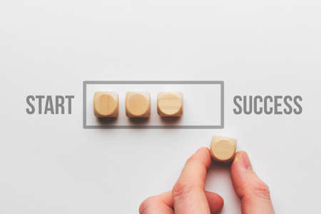 Success path concept with wooden cubes loading bar