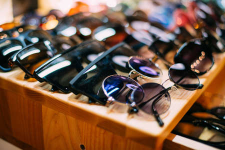 Sunglasses lie on the counter in the store.